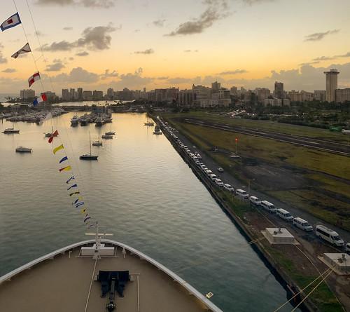 cruiseship dock sunrise sailboats highrises flags port skyline runway clouds puertorico yacht
