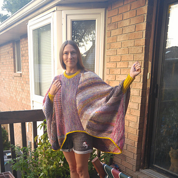 Lani (zanderlidy) knit this awesome Marled Magic Sweater & Dress by Stephen West not recently but still...What a stash buster!