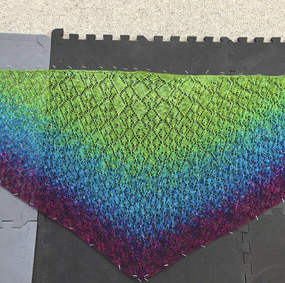 Heidi (eweandiyarn)'s finished and blocked Fruit Cocktail. Yarn is from @coriand3r. Thank you to Sea Turtle Craft Co for convincing me one more repeat in purple!