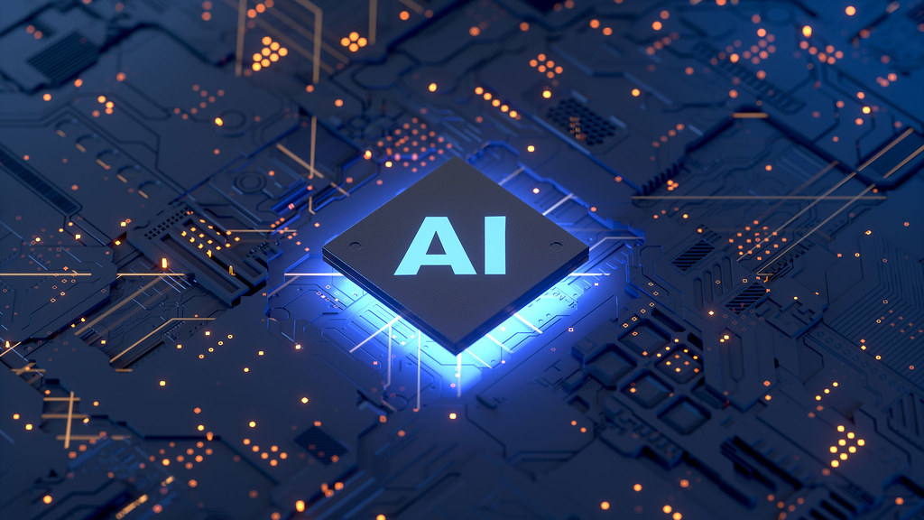 A close up of a microchip and processor with the letters AI on it