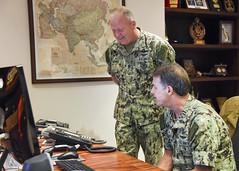 Adm. John C. Aquilino, commander of U.S. Pacific Fleet, and Fleet Master Chief Jim Honea notify the Sailors of the Year via phone call, April 16. (U.S. Navy/MC1 Nate Laird)
