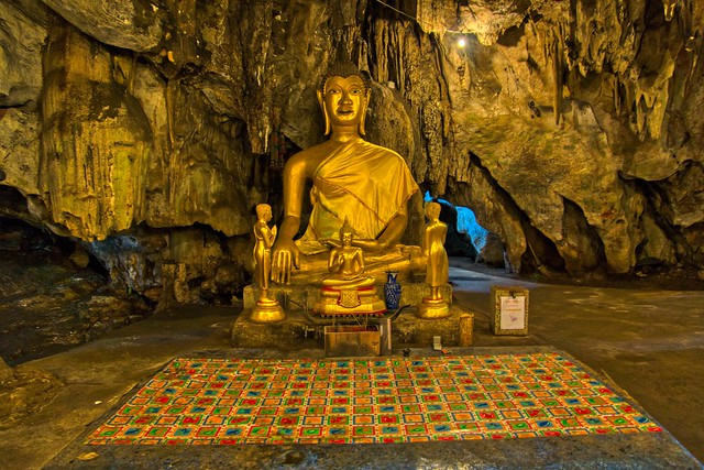 Buddha images in the cave at Wat Tham Khao Poon in Kanchanaburi, Thailand