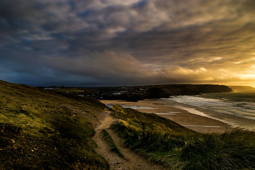 20200317192856 europe britain england cornwall perranporth coast sunset sanddunes beach sky clouds headland sea atlantic weather scenic