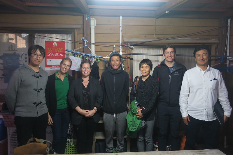 The Green Fins team standing in a dive shop and smiling at the camera during a scoping trip