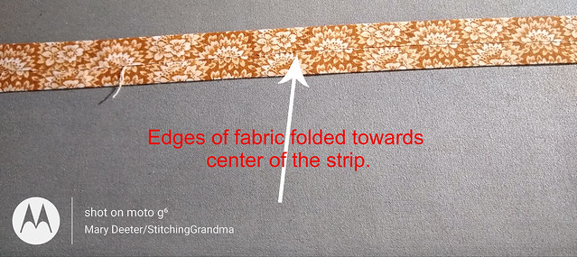 Edges folded toward center of the strip
