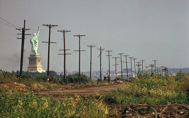 The Statue of Liberty surrounded by an abandoned wilderness where the southern end of Liberty State Park now exists. (Black Tom Island used to be right here). As a teen, I was fascinated by the bizarre no-man's land of the Jersey City shoreline. Aug 1976