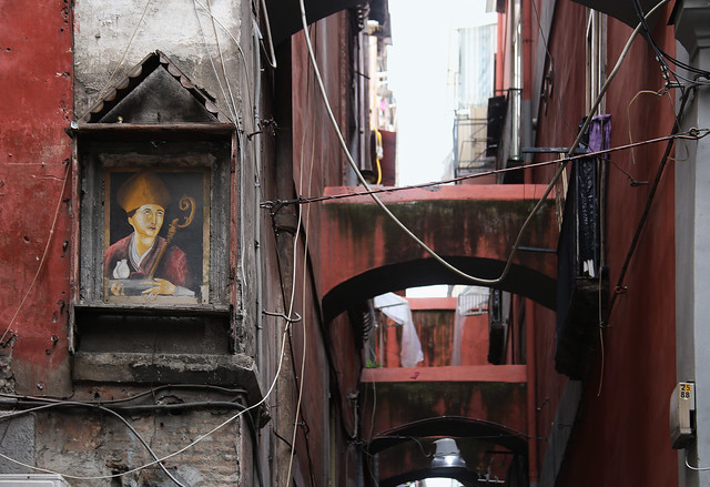 Traditional religious shrine embedded in street wall of Naples