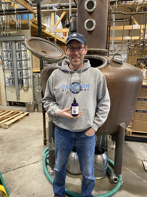Clayton Distillery owner Mike Aubertine in front of his equipment