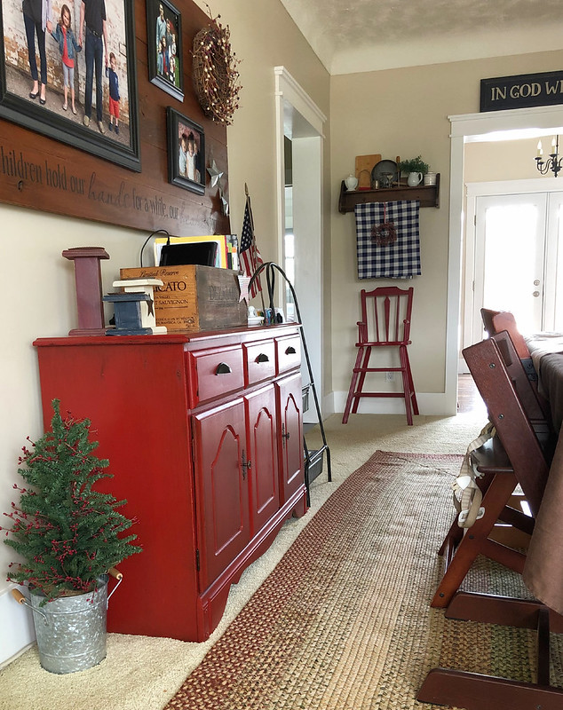 red buffet cabinet and antique high chair