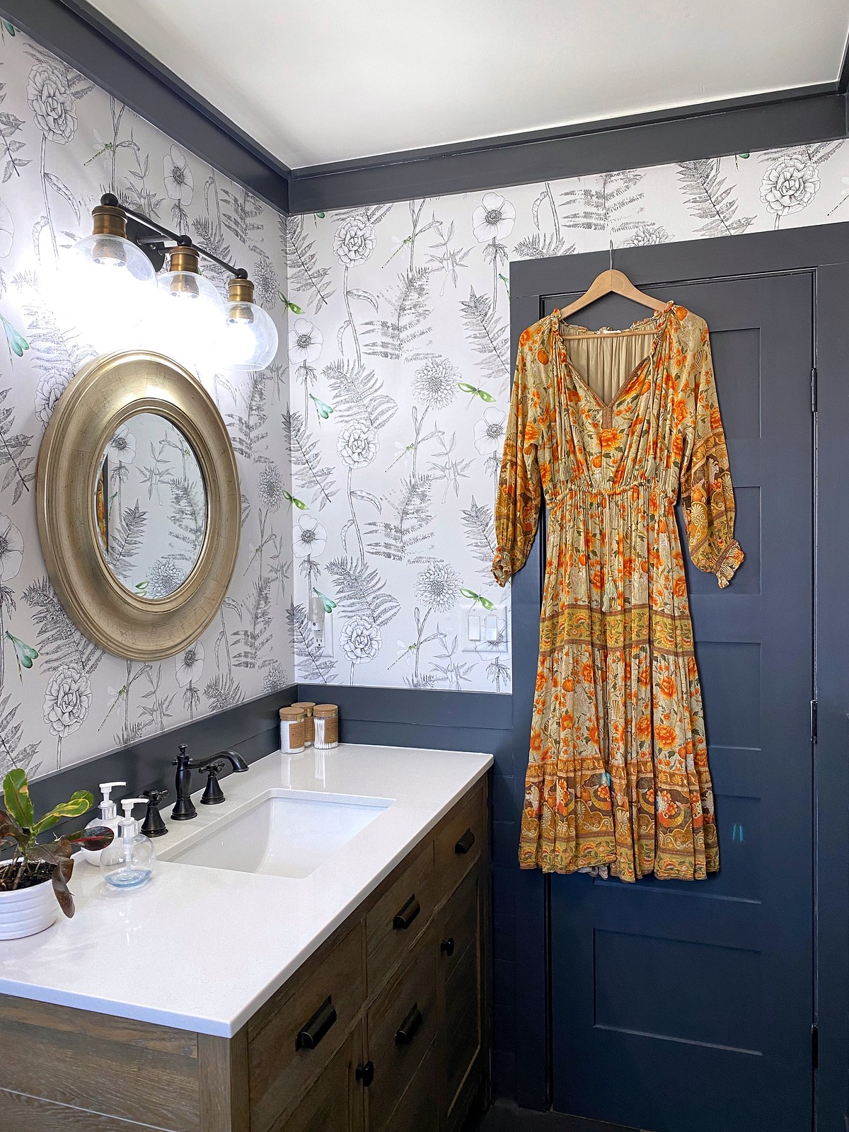 Wallpapered Bathroom | Wallpaper Bathroom | Powder Room | Black Door Black Trim | Flower Leaf Gray Wallpaper | Farmhouse Style Bathroom Renovation Inspiration