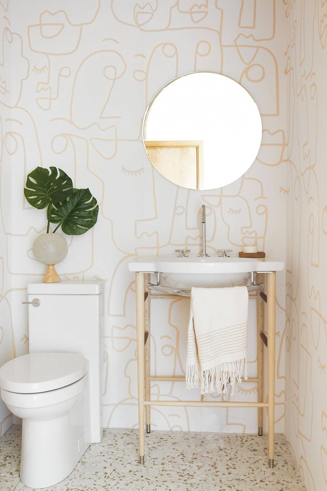 Subtle Muted Bathroom Wallpaper | Face Line Drawing Wallpaper | Pale Pink White Bathroom Inspiration | Light Airy Powder Room