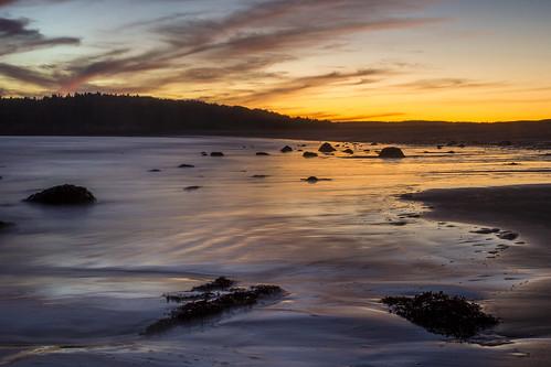 beach colour blur landscape dusk evening dark clouds glow calm serene