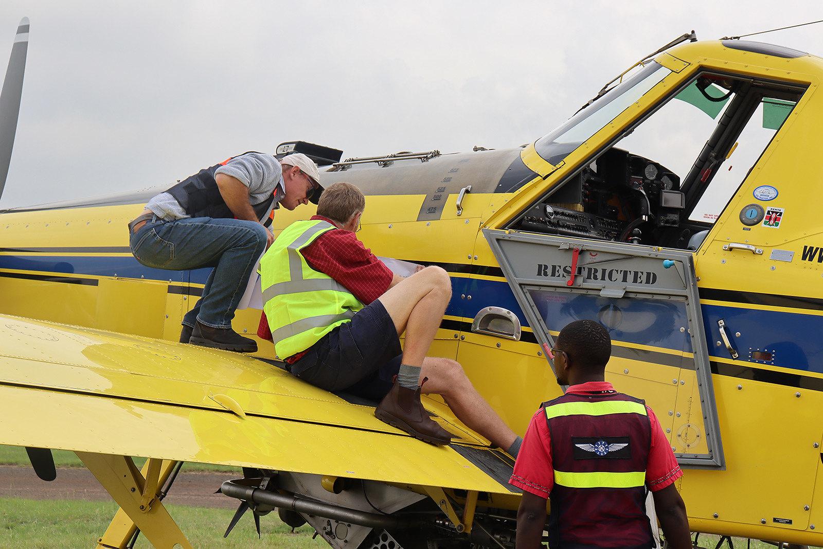 Preparing airplane for desert locust control operations in Kenya
