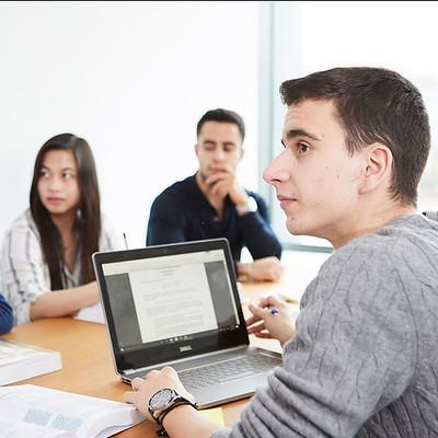 Economics students in a seminar room