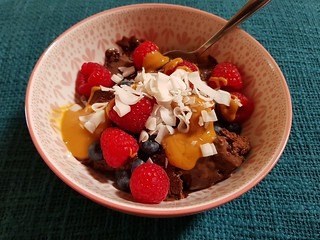 Sundae with So Delicious Chocolate Fudge ice cream, PB, berries, coconut flakes
