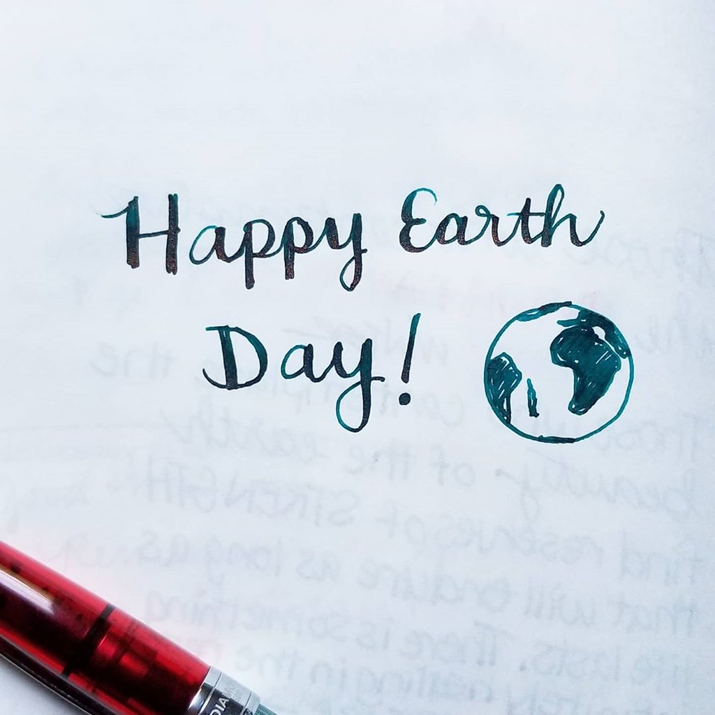 """Happy Earth Day!"" handwritten in teal ink"