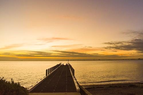 silhouettes brighton melbourne sunset solitude portphilipbay australia water pier clouds