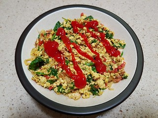 Scrambled tofu with fried shallots, bacon bits, spinach