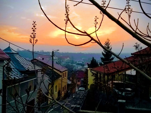 turda romania motorola sunset sky houses city architecture cars hill buildings roof clouds