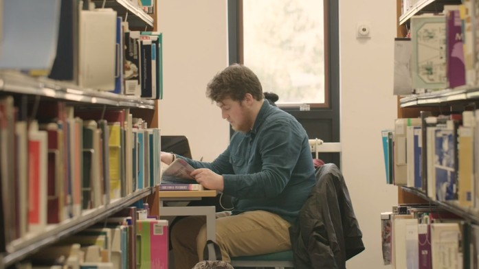 Dylan working in the Library