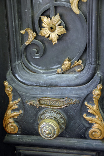 Door with a 'buzon' for the mail with gilded swirls and swashes typical of Fileteado Porteno, a popular style of decorative art in Buenos Aires, Argentina