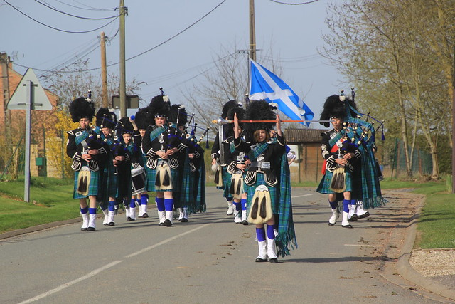 Marching past The Pipers Memorial, Longueval, The Somme, WW1, France.