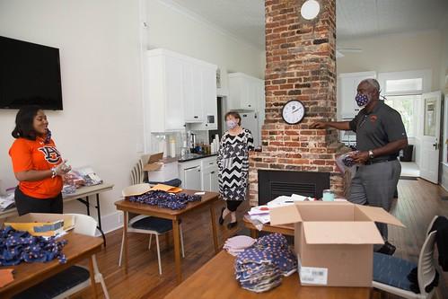 Elizabeth Essamuah-Quansah, Scott Bishop and Royrickers Cook talking in an office.