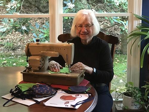 Margaret Craig-Schmidt sewing a mask.