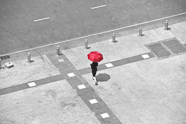 Woman with a red Ombrella