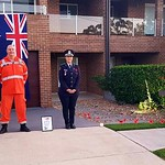 Cherie Smith_myself and husband Chris after the Dawn Service in our driveway this morning, complete with the Australian Flag hanging from our balcony and homemade poppies