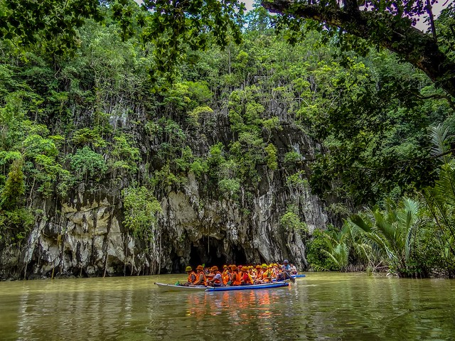 Boat tour along the tropical river.