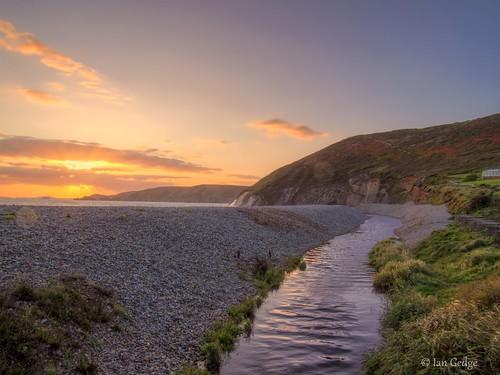 uk britain wales cymru pembrokeshire beach coast sunset sea newgale