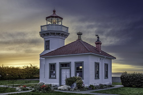 lighthouse mukilteo light house view color dark sunset shine old historic history ship ferry pnw