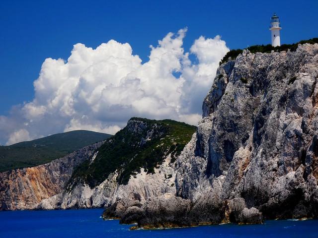 Sea, sky, cliffs and lighthouse