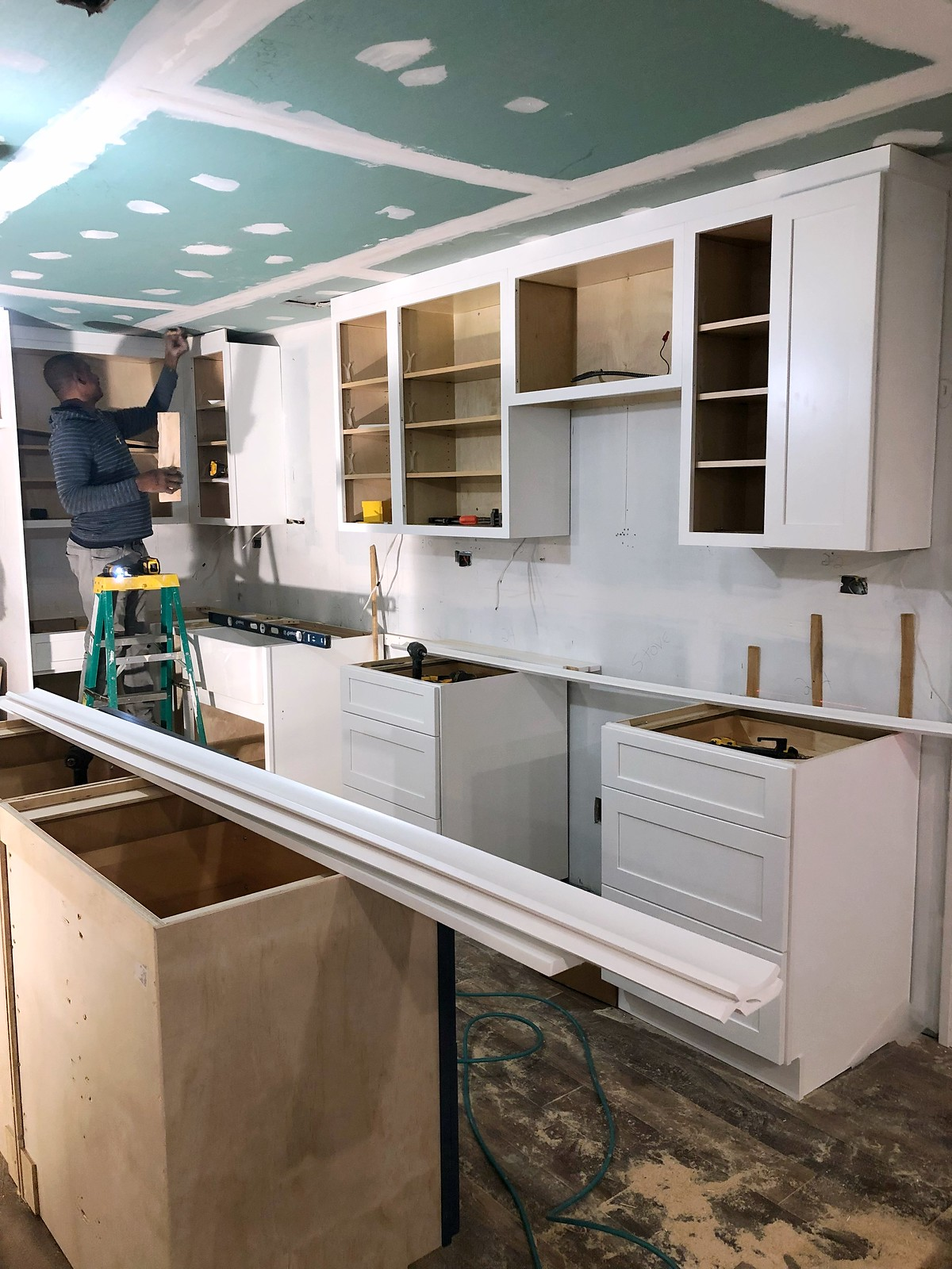 All White Cabinet Install | Before & After: My New York Apartment Kitchen Renovation | 1970s Apartment Small Kitchen Redesign | Living After Midnite Jackie Giardina
