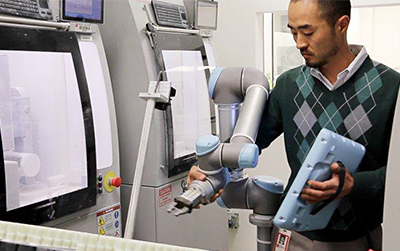 A UR5 cobot collaborating with a healthcare worker.