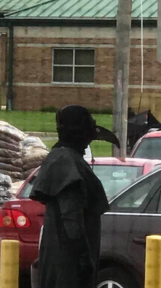 human dressed as raven
