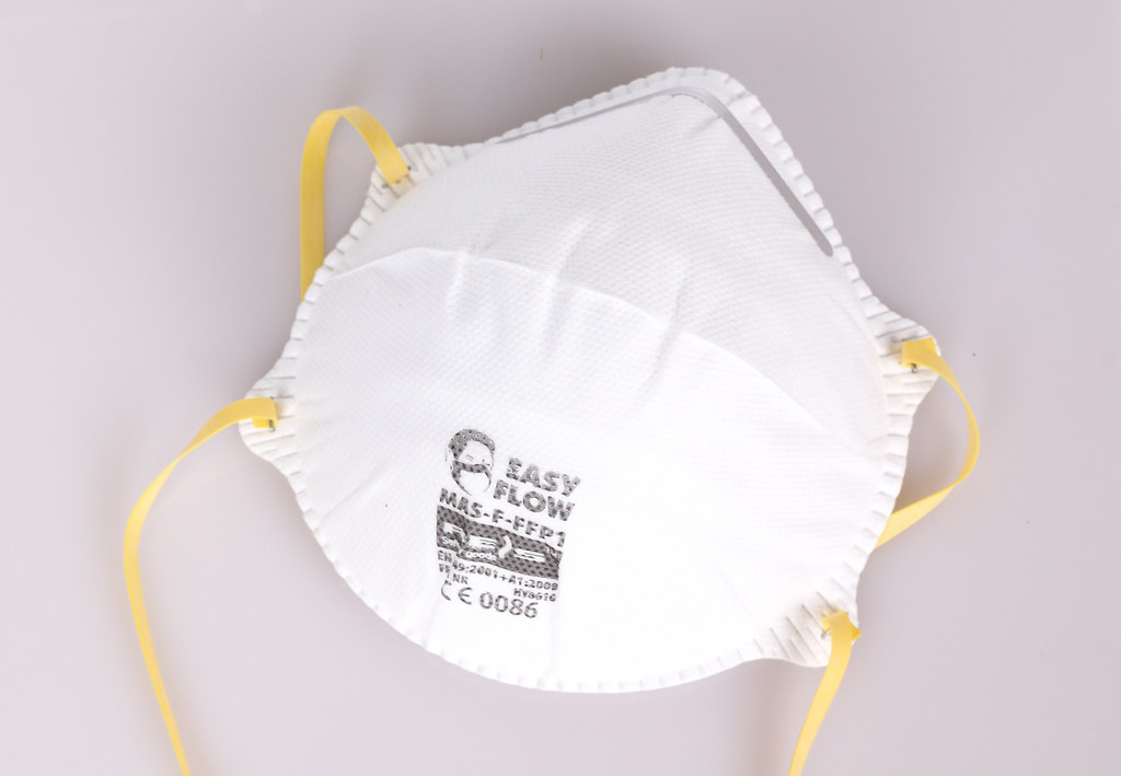 Face mask or dust mask or filtering facepiece respirator - breathing protection against air pollution or flu or virus outbreak