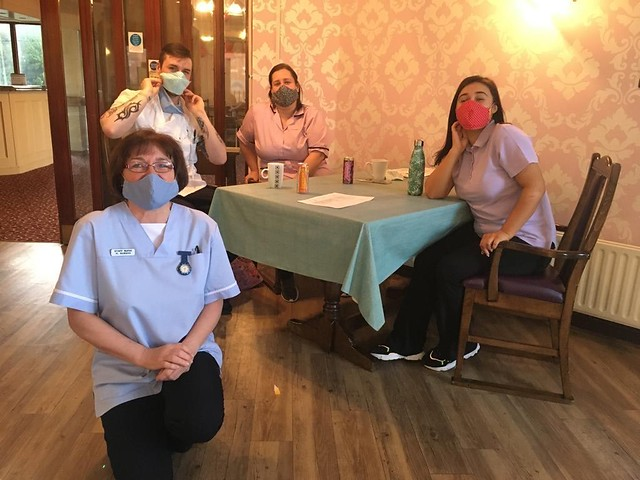 Care home staff try out the facemasks made by the Nimble Fingers group at Lisburn Cathedral.
