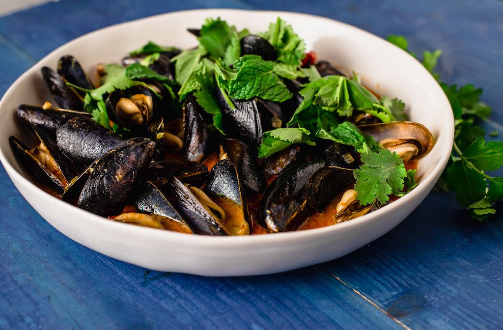 Steamed coconut curry mussels layered with Thai inspired flavors of red curry paste, ginger, garlic garlic and creamy coconut milk.