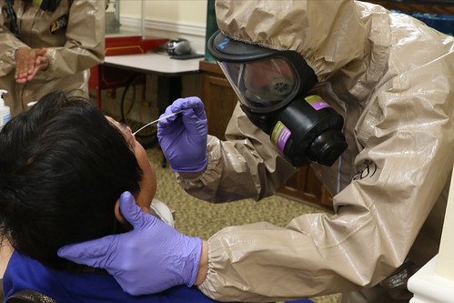 Va. National Guard personnel collect samples for COVID-19 testing