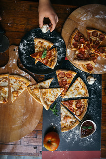 Creative sliced pizza from above.
