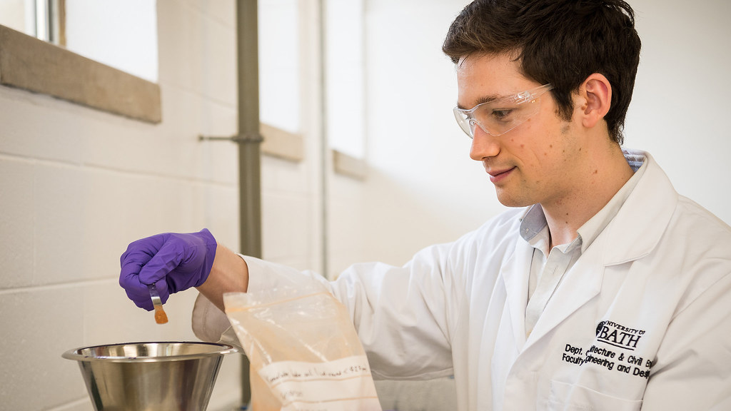 A PhD student examines his soil samples in our lab.
