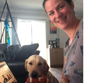 Emily Shryock and Maple, working from home.