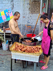 China, Beijing - Duck necks and heads cooked in a hutong street kitchen - July 2010