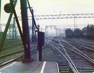 A foggy, misty morning at the Hoboken Erie Lackawanna Terminal looking at the tracks from the very end of one the passenger platforms where nobody ever ventured. I still recall the smell of diesel and machine oil which permeated the place. March 1975