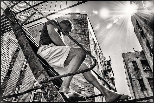 The new norm in NYC. Fire escape sunbathing. Social distancing covid 19.