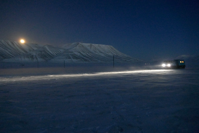 Driving along Adventdalen in Full Moon