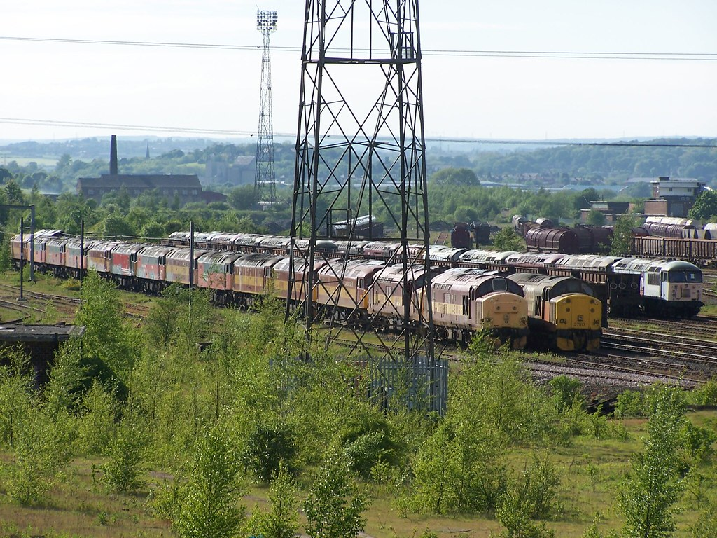37688, 37517 & 56124 Front locos in each line Healey Mills 26 05 2005 by ChrisDPom