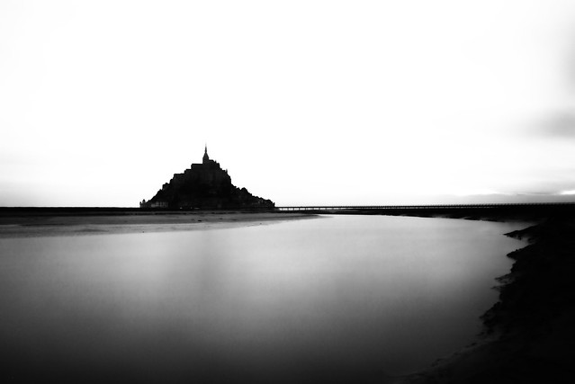 minimalist fine art B&W of the iconic island abbey and fortress at dawn. Mont Saint Michel, Avranches, Manche, Normandie, France